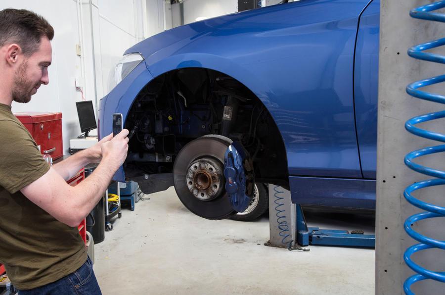 Dan Prosser admiring the M135i's new brake