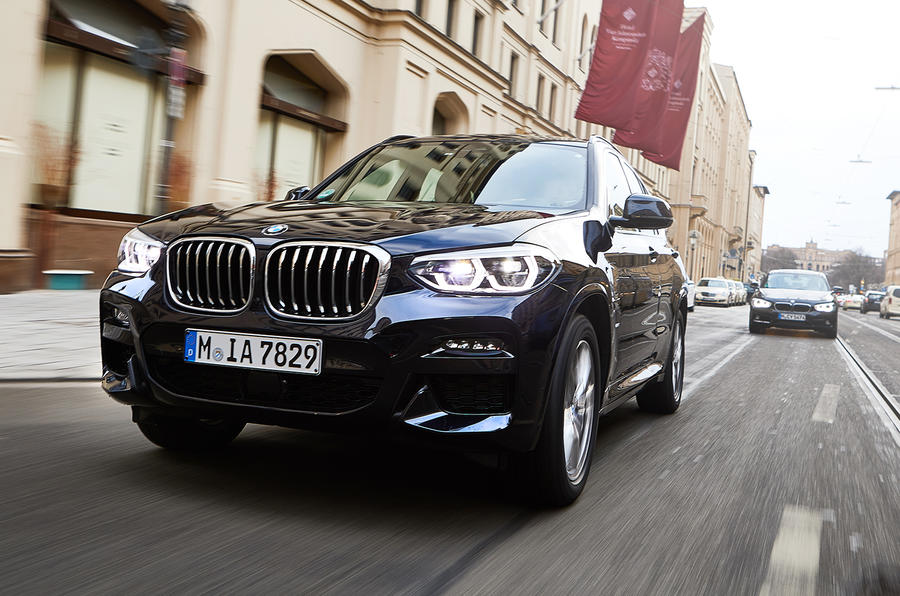 BMW X3 PHEV official press images - on the road