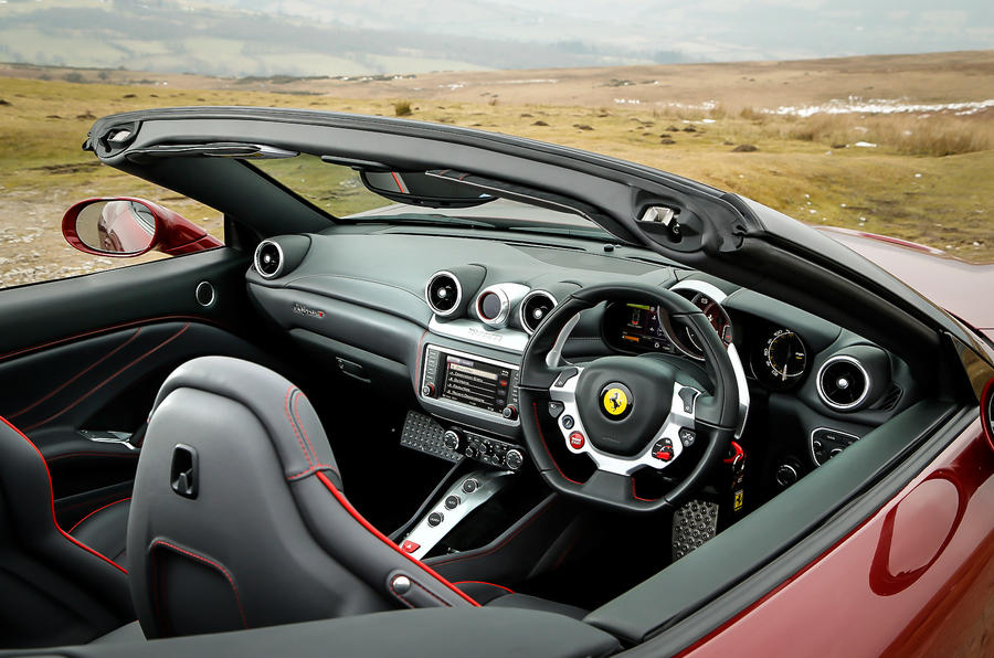 Ferrari california t vs porsche 911 turbo s aston v12 for Ferrari california t interieur