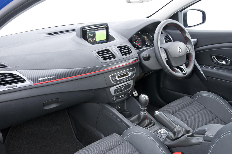 The GT 220 interior features sports seats and a leather-rimmed steering wheel
