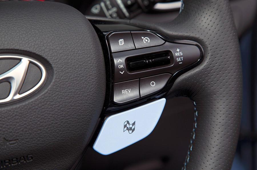 Volkswagen Golf GTI vs Hyundai i30n hyundai steering wheel drive mode button