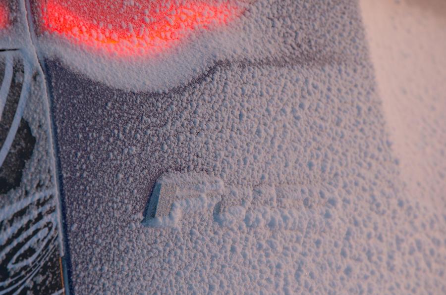 Jaguar F-Pace snow-covered badge