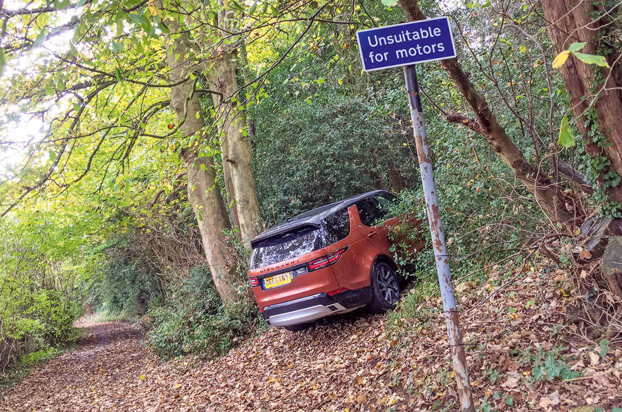 Land Rover Discovery parked up in the bushes