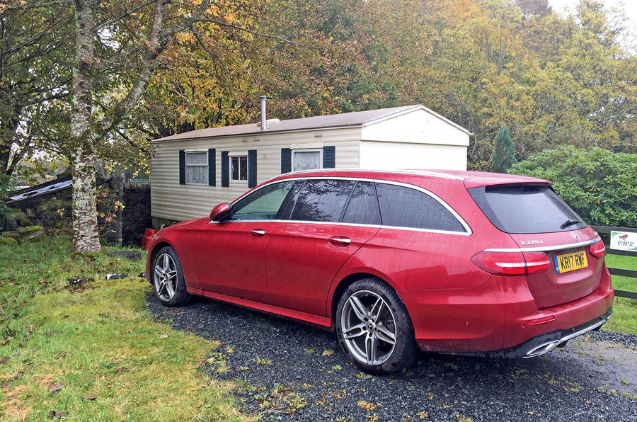 Mercedes-Benz E-Class Estate outside the static caravan