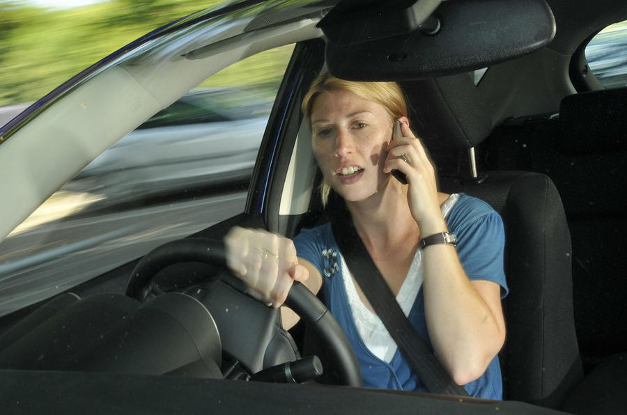 Record number of UK drivers caught using phones behind the wheel last year