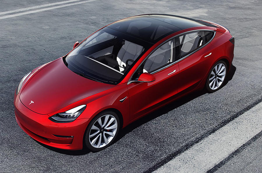 Red Tesla Model 3 press photo