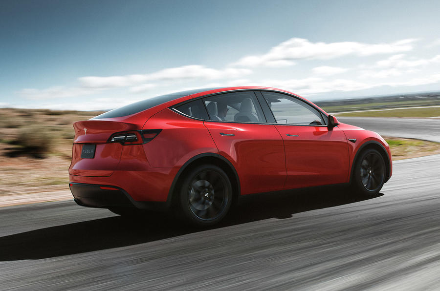 Tesla Model Y on the road red