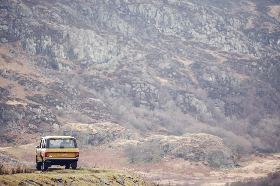 1978 two-door Range Rover before a mountain