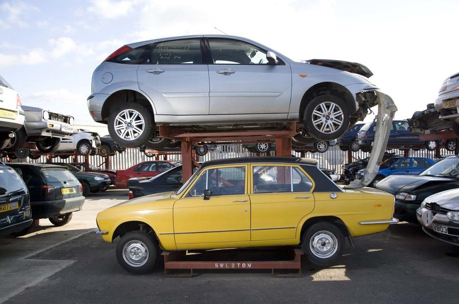Triumph Dolomite and Ford Focus at scrapyard