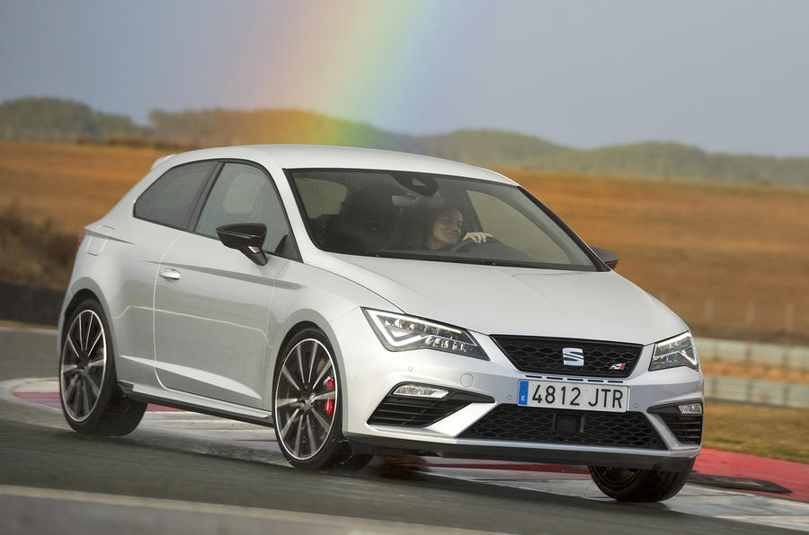 Seat Leon Cupra 300 with a rainbow above it