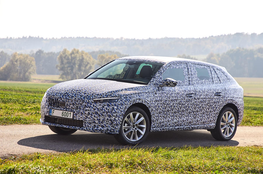 Camouflaged Skoda Scala near side