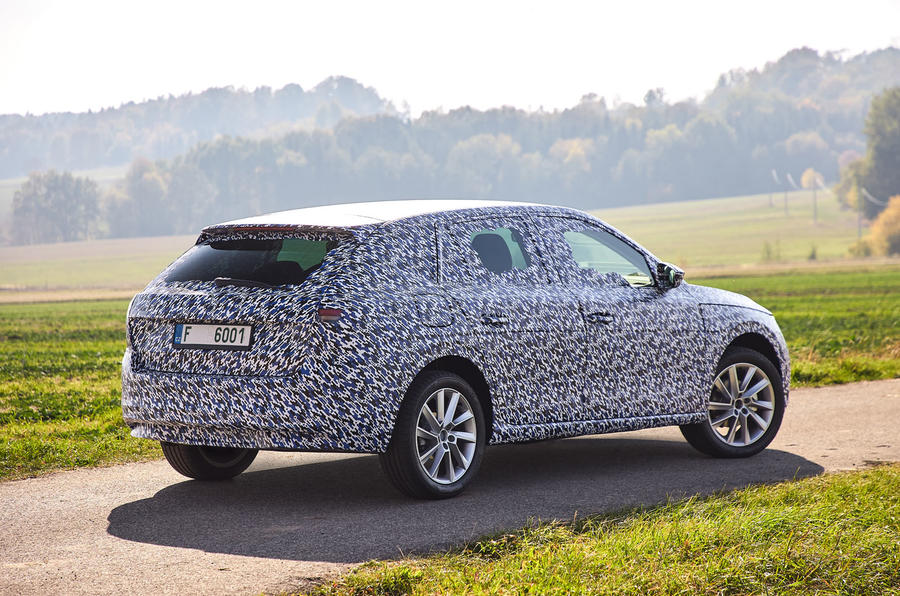 Camouflaged Skoda Scala rear three quarter