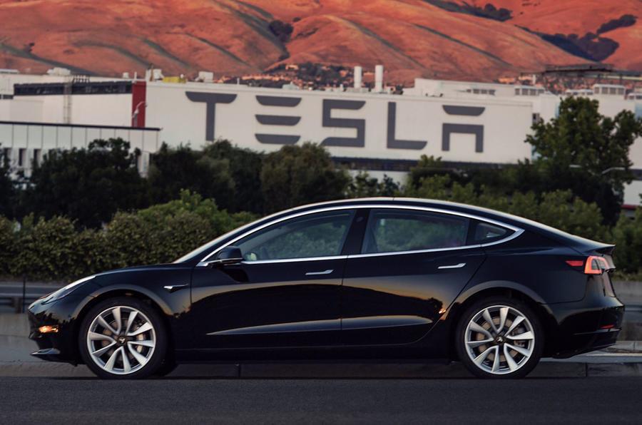 Tesla logo and car