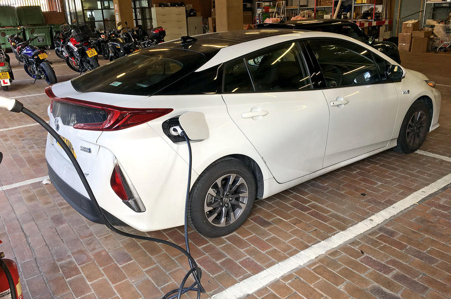 Toyota Prius PHEV charging in the bosses' space