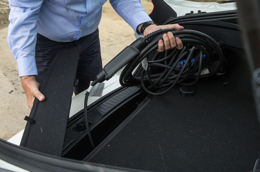 Toyota Prius PHEV putting away the charging cables