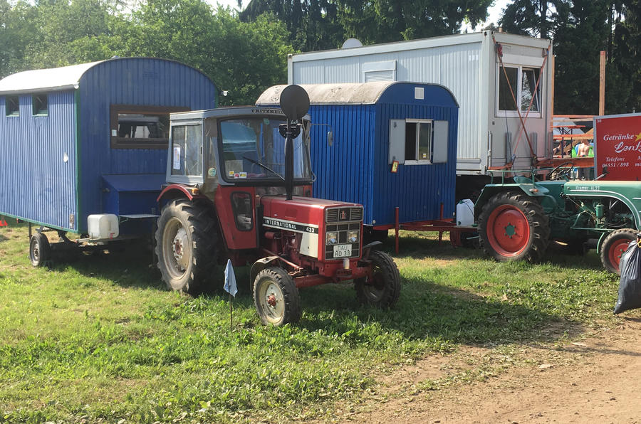 "This is how the local N24 fans roll. With a tractor - and what looks like a homemade corrugated caravan. ""Have you come far, then?"""