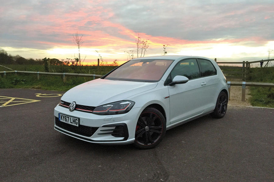 Volkswagen Golf GTI under a pink sky