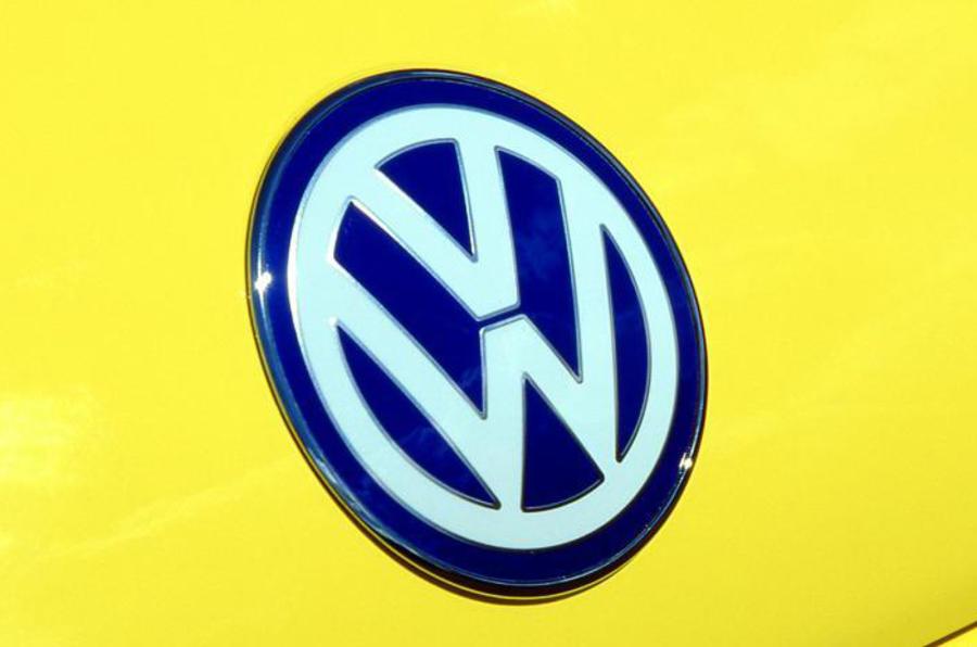 VW loss profits emissions