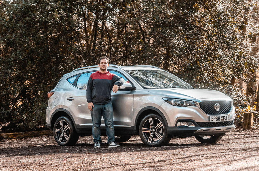MG ZS 2019 long-term review - Olgun posing with car