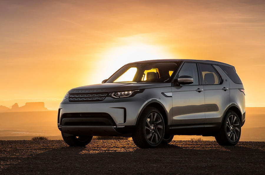 Land Rover Discovery posturing at dusk