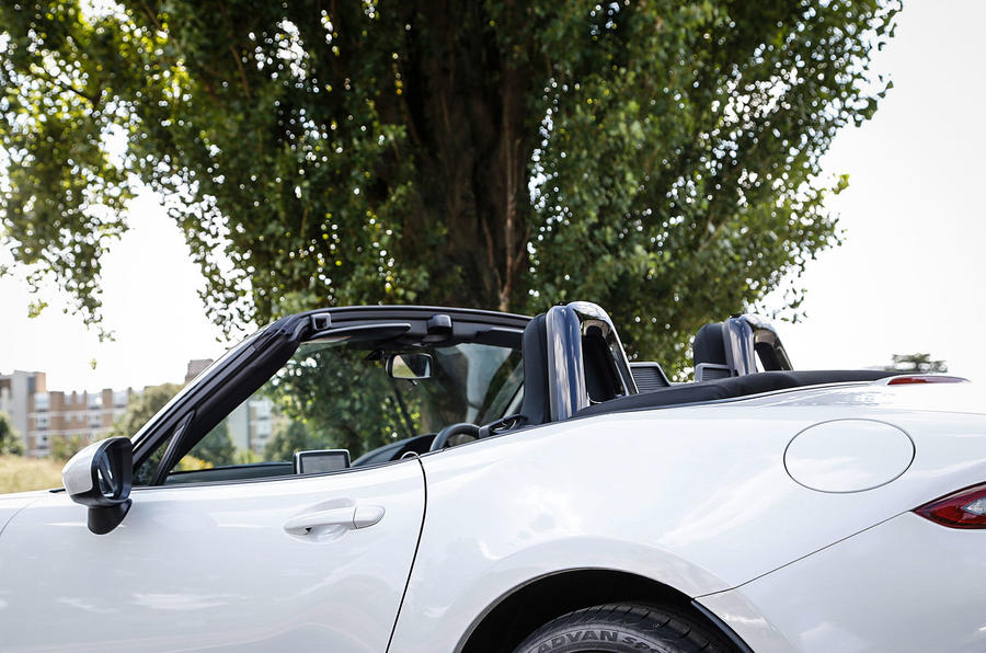 The roof folds neatly behind the Mazda MX-5's seats and can be operated by one hand