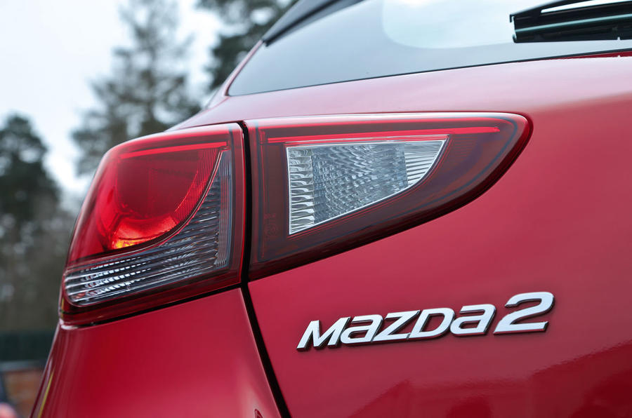The Mazda 2's rear light cluster is similar to the 3, but not the same due to space constraints