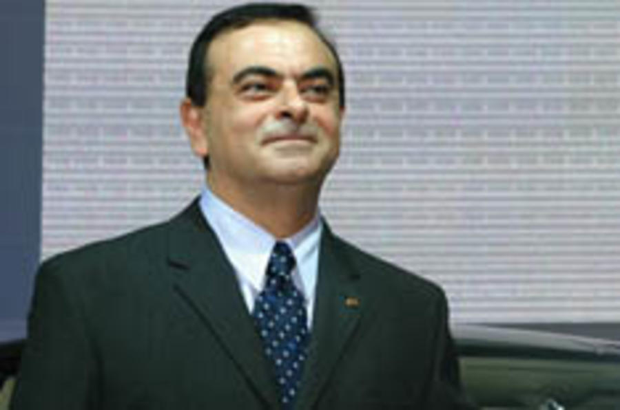 Nissan's Ghosn vows to stay on