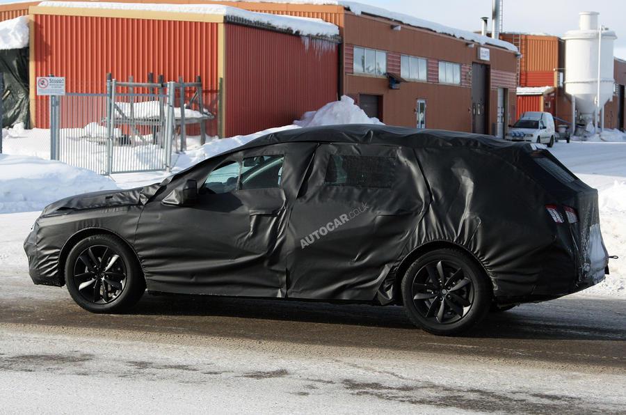 New Peugeot 508 estate spied
