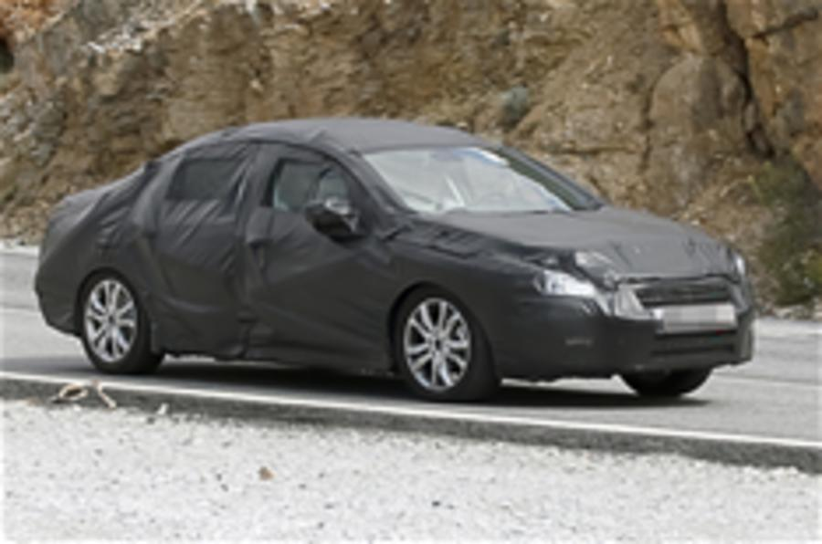 New Peugeot 408 spied