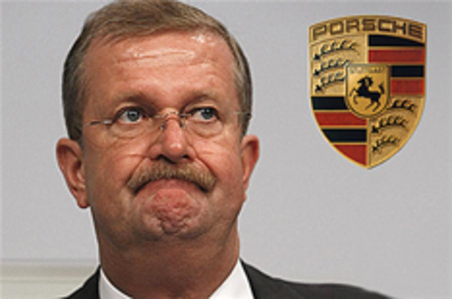 Porsche boss quits; VW merger on