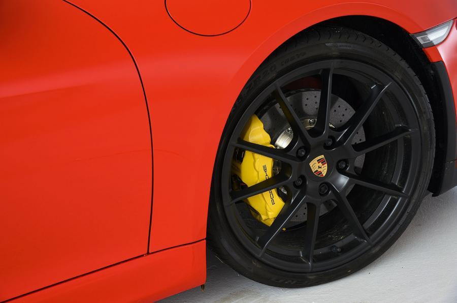 Yellow Porsche brake calipers