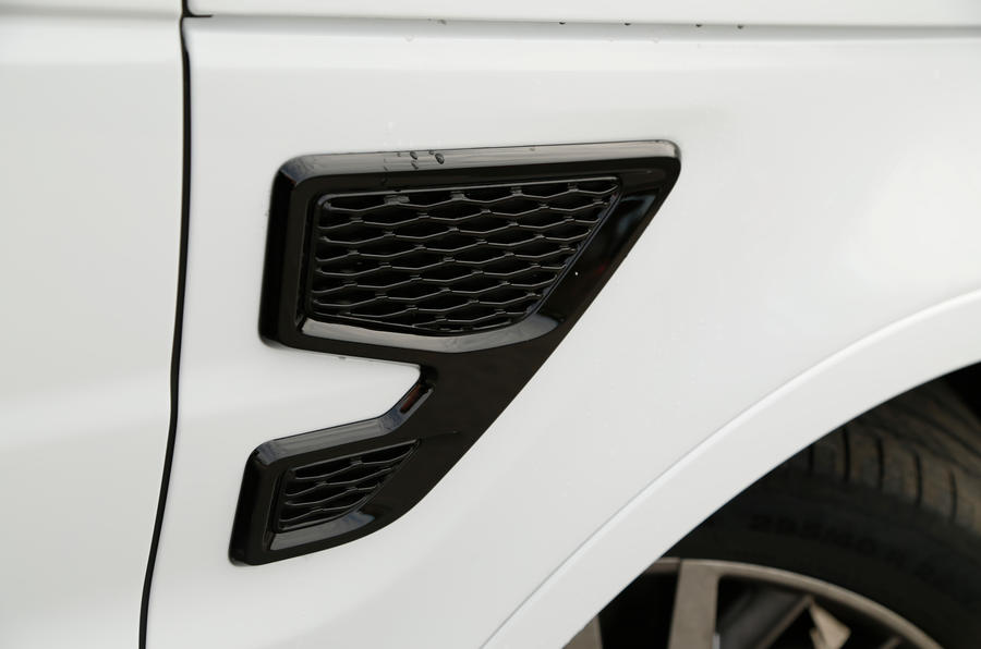 Gloss black dressing on the radiator, bonnet and front wing vents gives the Range Rover Sport SVR stealthy looks