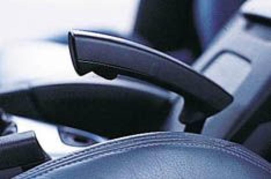 Saab puts the brakes on