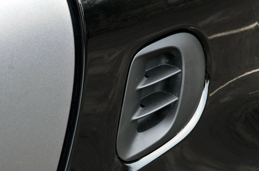 The one air vent is to keep the Smart Fortwo symmetrical as the other side is the fuel flap