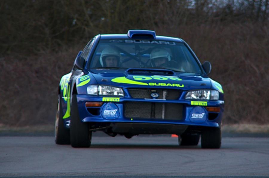 Three Subaru rally cars driven