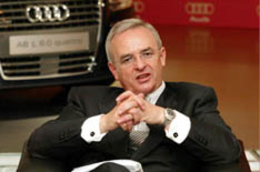 VW profits plunge