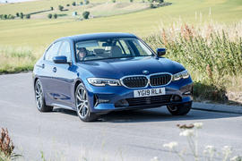 BMW 318d front three quarters on the road