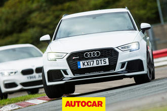 Audi RS3 versus BMW M140i review - hot hatch track battle